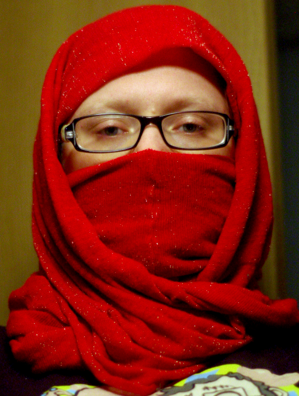 me, wearing a red scarf wrapped around my head, only the eyes visible
